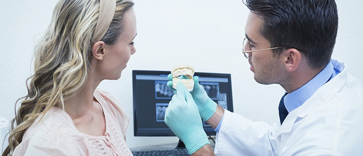 Dentist presenting to patient to help increase dental practice revenue