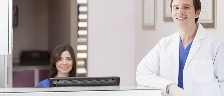 Receptionist and Dentist scheduling dental hygiene appointments